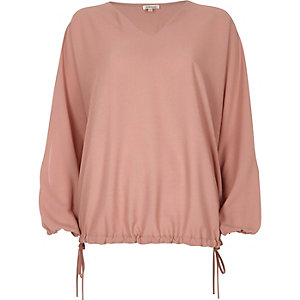 Light pink textured ruched sleeve top