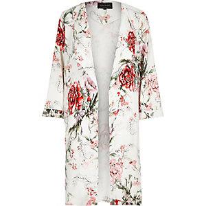Manteau blanc à imprimé floral
