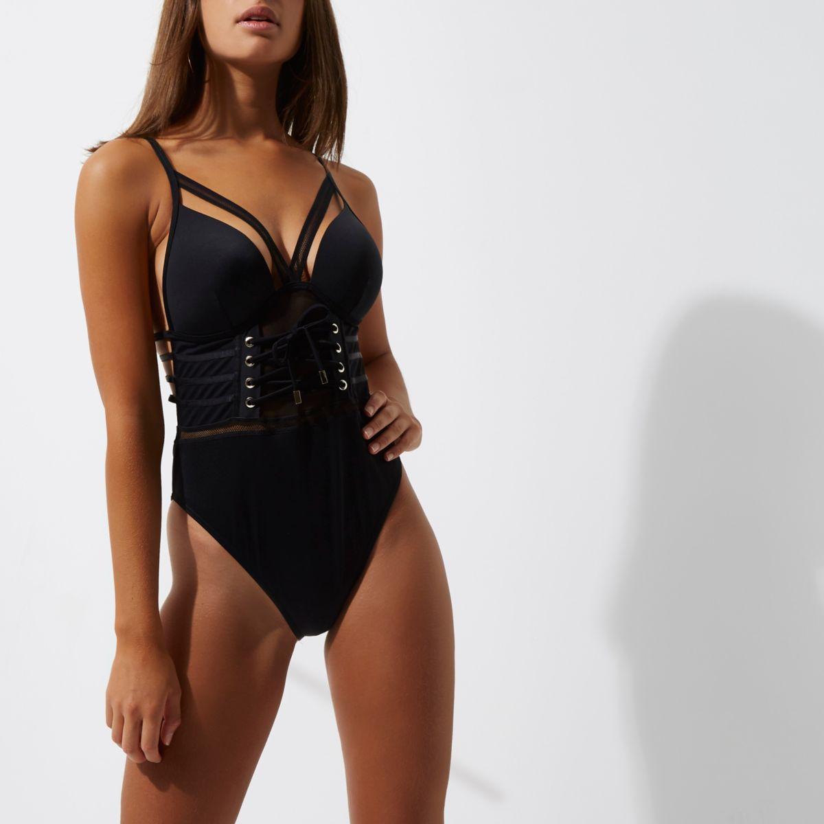 Zwarte mesh laag uitgesneden zwempak met bandjes en corsetsluiting