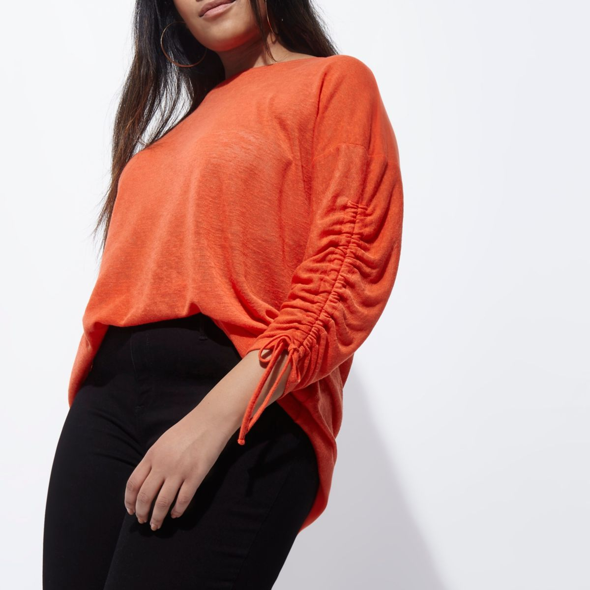 Plus red ruched sleeve top