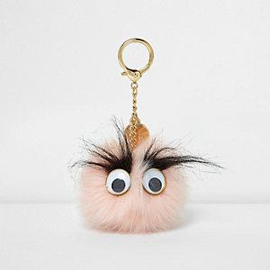 Porte-clés à pompon rose clair avec yeux 3D