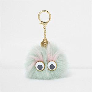Porte-clés à pompon vert clair avec yeux 3D