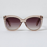 Beige oversized zonnebril met  doorzichtige getinte glazen