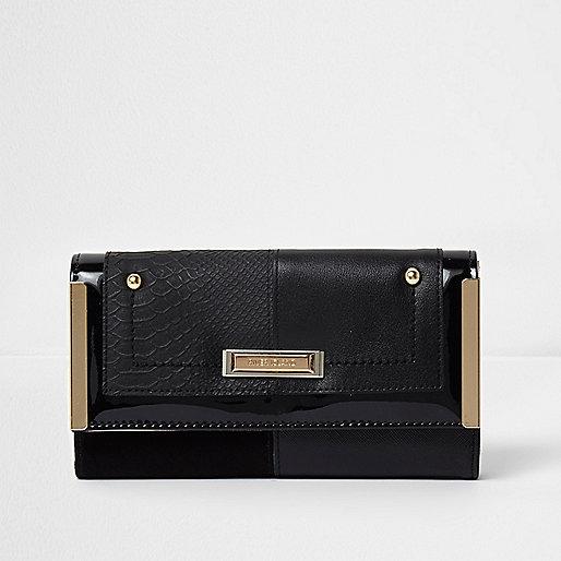 Zwarte smalle portemonnee met metaal aan zijkant