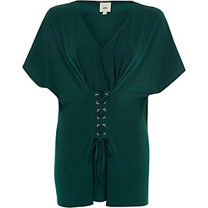 Groene top met V-hals en corsetdetail voor