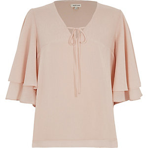 Light pink frill sleeve tie neck top