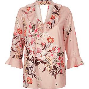 Top à fleurs rose avec ras-de-cou et volants