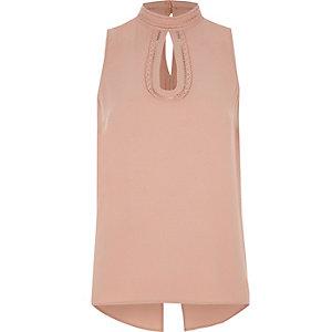 Roze hoogsluitende mouwloze top met gehaakte rand