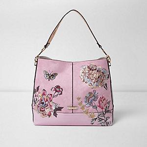 Roze ruime onderarmtas met geborduurde bloemen