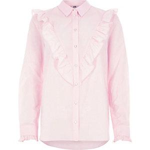 Chemise rose avec plastron à volant oversize