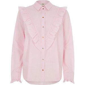 Chemise rose avec plastron à volants