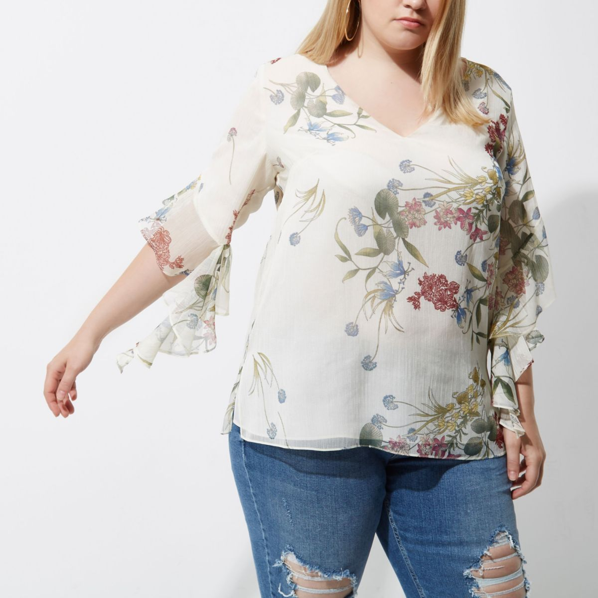 Plus cream floral print frill sleeve top
