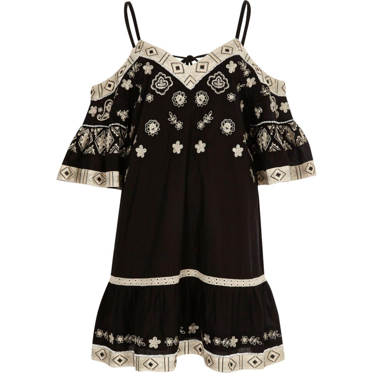 Schwarzes und cremefarbenes verziertes Swing-Kleid