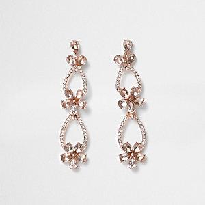 Boucles d'oreille façon or rose avec pendentif fleur pavée