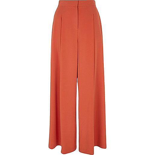 Rust orange wide leg trousers