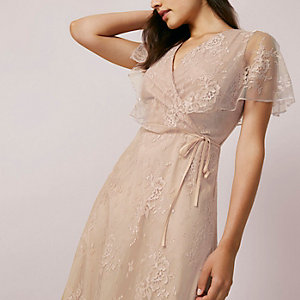 Light pink lace asymmetric hem midi dress