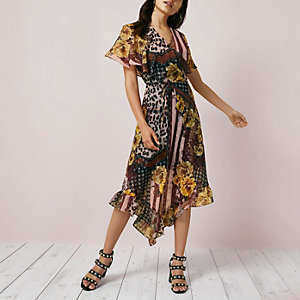 Pink mixed print asymmetric hem midi dress