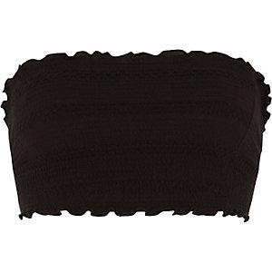 Zwarte gesmokte crop top met bandeauhalslijn