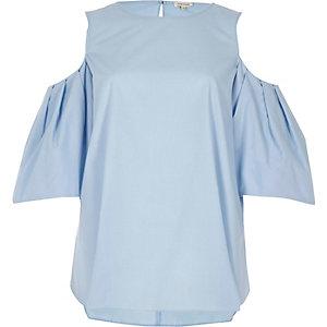 Haut bleu clair à épaules dénudées
