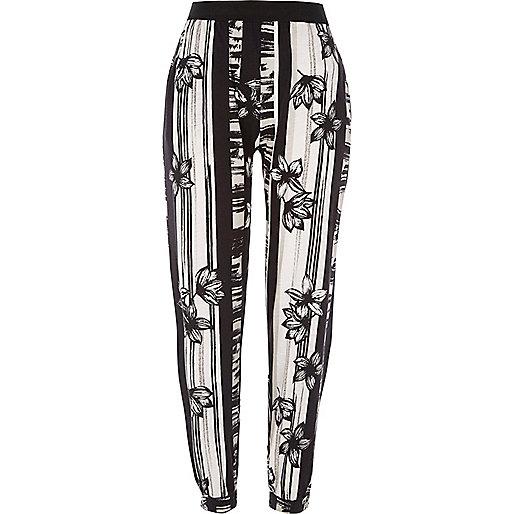 Pantalon de jogging en jersey flammé imprimé fleuri noir