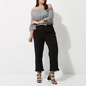 RI Plus - Zwarte cropped broek met kwastjes aan de zoom