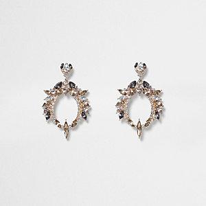 Boucles d'oreille dorées avec pendentif ouvert ornées de pierres
