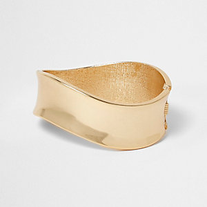 Gold tone wavy cuff bracelet