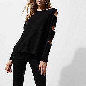 Zwarte gebreide pullover met scheuren in de mouwen en ladderdetail op de rug