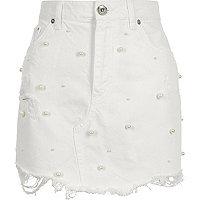 White faux pearl embellished denim mini skirt