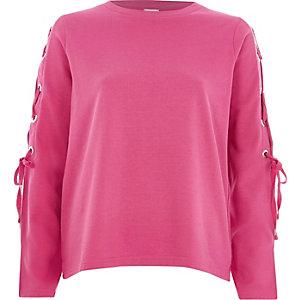 Roze sweatshirt met veterdetail op de mouwen