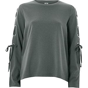 Kaki sweatshirt met veterdetail op de mouwen