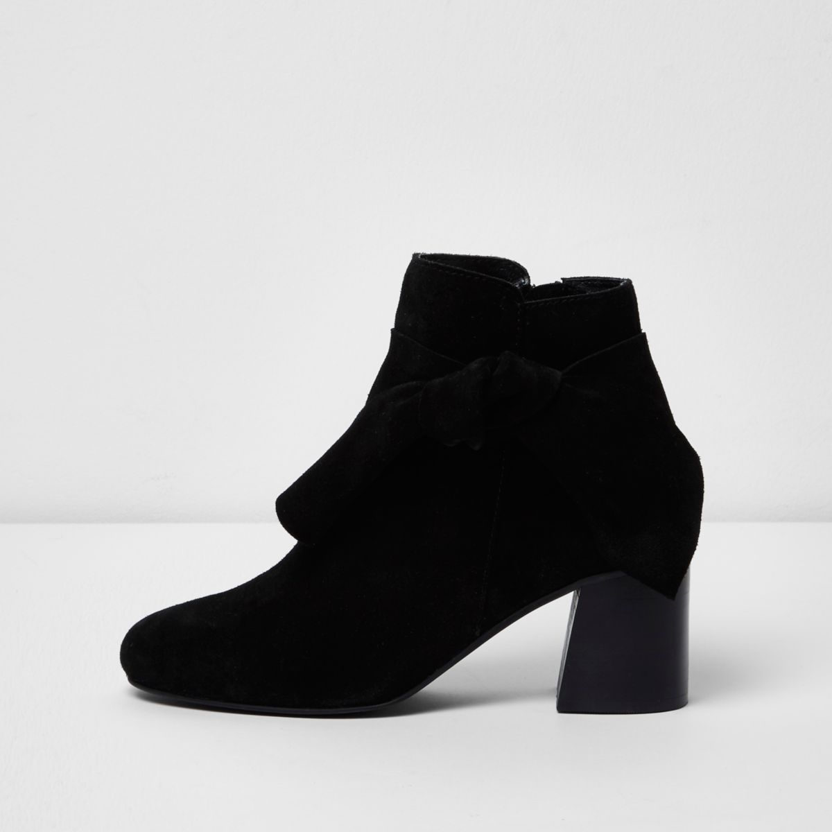 Black suede bow side ankle boots