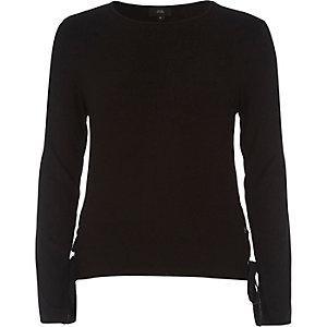 Top en jersey noir à manches longues noué sur les côtés