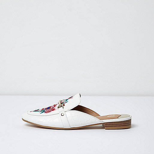 White embroidered snaffle backless loafers
