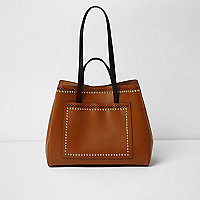 Tan leather studded laser cut tote bag