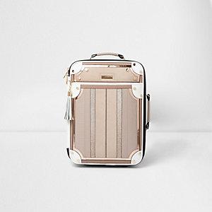 Crème koffer met verschillende texturen en panelen