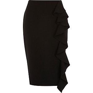 Jupe crayon noire avec volants sur le devant