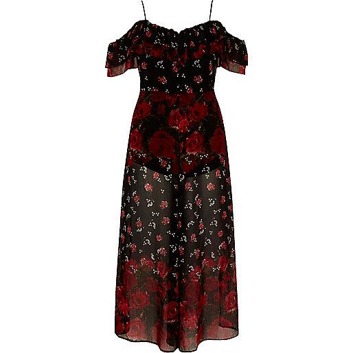 Zwarte jumpsuit met broekrok en bardothalslijn met bloemenprint
