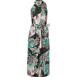 Robe mi-longue imprimé tropical verte à encolure montante nouée à la taille