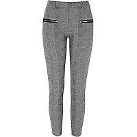 Zwarte geruite skinny-fit broek met rits voor