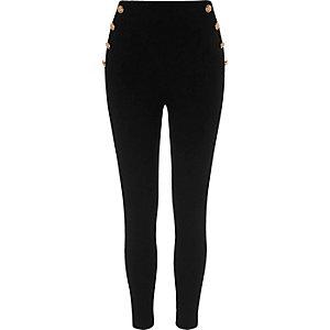 Zwarte legging van ponte-stof met knopen opzij