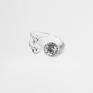 Zilverkleurige opengewerkte ring met siersteentjes