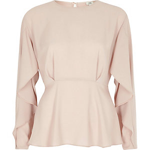 Lichtroze blouse met lange mouwen en ruches