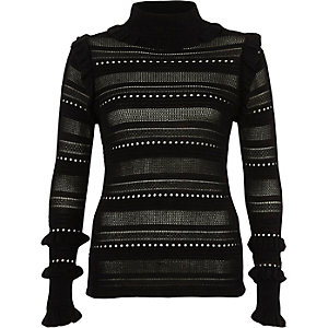 Black pointelle knit turtle neck sweater