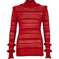 Red pointelle knit turtle neck sweater