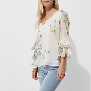 Petite cream floral frill bell sleeve top