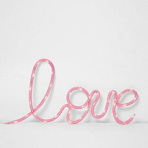 Roze 'love' neonverlichting