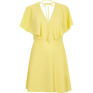 Yellow tie neck cape dress