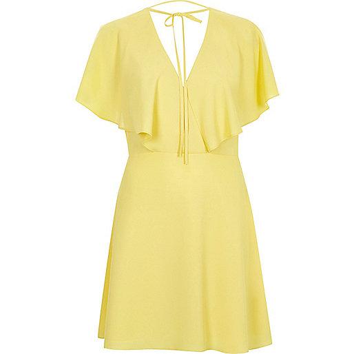 Yellow tie neck cape dress