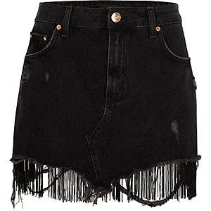 Mini-jupe en jean noir usé avec ourlet à franges